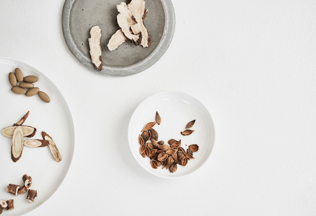 Chinese Herbal medicine ingredients in Zilch Acne Formula on some plates