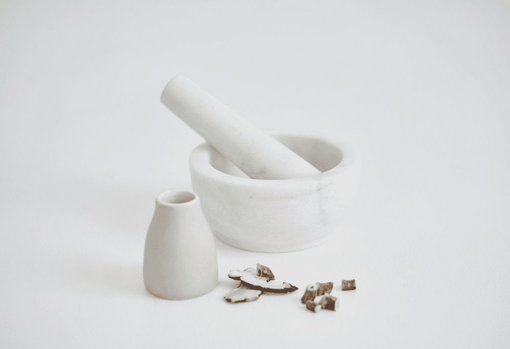 Mortar and pestle with Chinese Herbal Medicine in Zilch Acne Formula